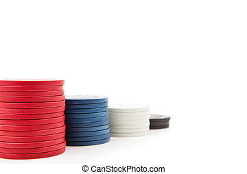 Piles of poker tokens against a white background