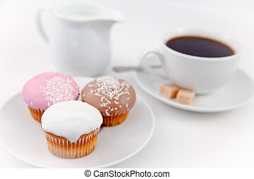 Small muffins and coffee on white plate with sugar and milk...
