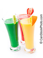 Full glasses with fruits pieces against white background