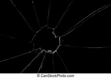 Broken and crackled glass against a black background