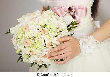Wedding bouquet - bouquet in the hands of the bride