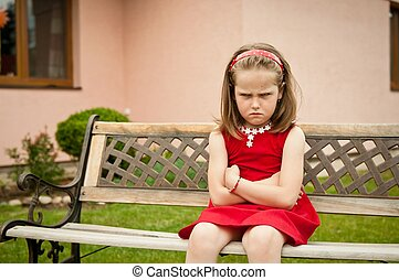 Offended child portrait - Outdoors portrait of small cute...