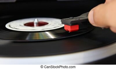 old music player - Vinyl record spinning on turntable close...