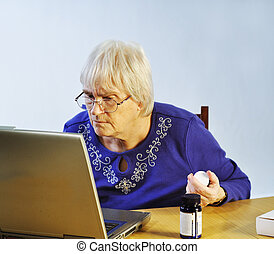 Medication On-Line - senior woman buying her medication...