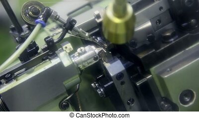 Automatic chain-bending machine in action, closeup view