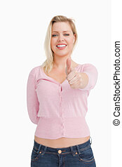 Joyful woman placing her thumbs up