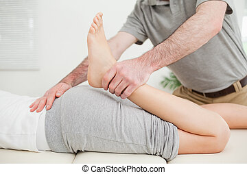 Close-up of a woman lying while being stretched