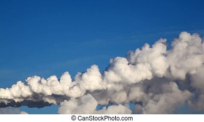 White smoke from heat electropower station on morning blue...