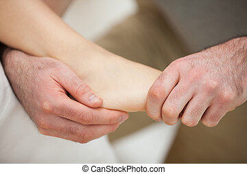Foot being stretched by a physiotherapist