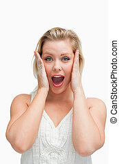 Surprised blonde woman standing with her mouth opened