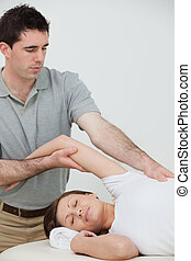 relaxed woman being stretched by a physiotherapist