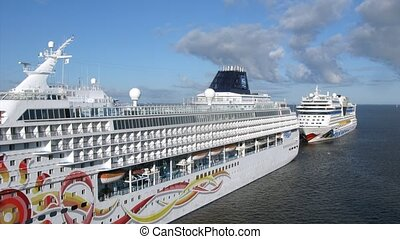 Cruise liners of NCL and AIDA cruise companies in port -...