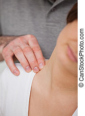 Close-up of a man massaging the nape of a woman in a room