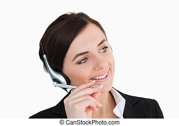 Businesswoman in black suit using a headset against white...