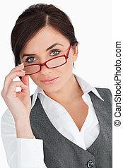 Beautiful blue eyed secretary posing against white...