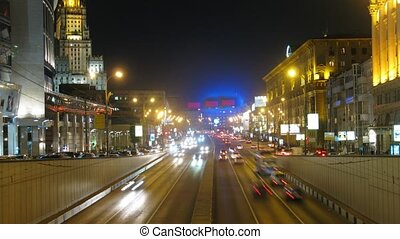 Cars go on Garden Ring on New Arbat in night city, time...