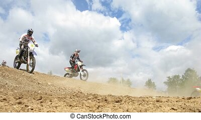 Motorcycle riders jump during enduro race - RAKOWO, RUSSIA -...