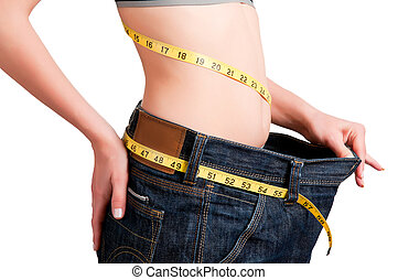 Diet Time - Woman seen how much weight she lost. Isolated...