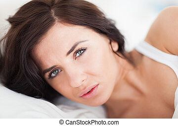 Serious brunette woman waking up