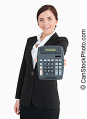 Businesswoman in black suit showing a calculator