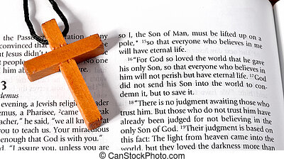 Cross on Bible verse John 3:16 - Wooden cross next to the...
