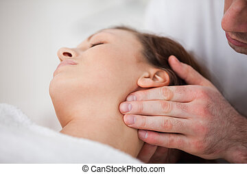Close-up of woman being massaging by a physiotherapist