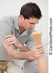 Doctor massaging a patient with his elbow