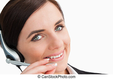 Smiling woman in suit using a headset