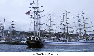 Ship docks in front of MIR barque to sea regatta -...