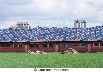 farm with solar panels - barn with its roof full with solar...