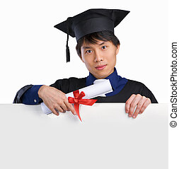 Graduated scholar pointing to white board - Graduated...