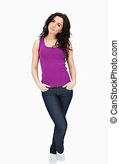 Woman wearing a purple top and a denim against white...