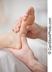 Foot receiving a massage by a physiotherapist in a medical...