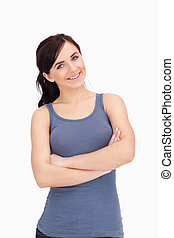 Young woman with folded arms against white background