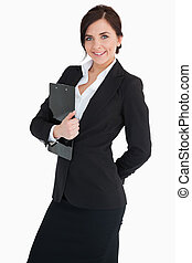 Smiling businesswoman holding a clipboard