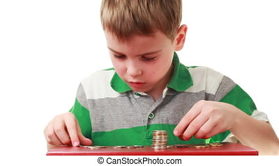 boy on red base count coins and put together, white...