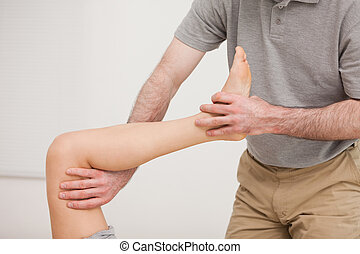 Leg of a patient being stretched