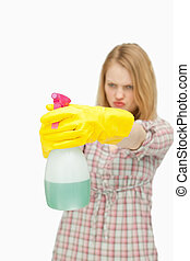 Young woman holding a spray bottle