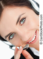 Green eyed woman with headset in close-up