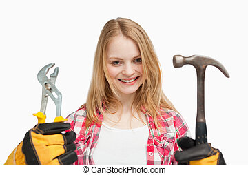 Woman holding tools while standing