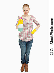 Woman standing while holding a spray bottle