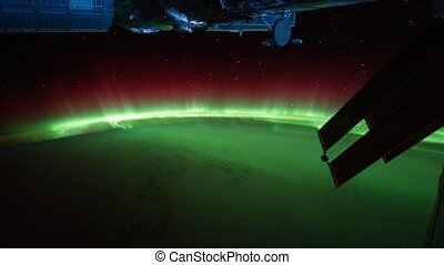 Polar lights visible on Planet Earth from shuttle window