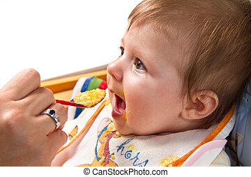 Little boy eating baby