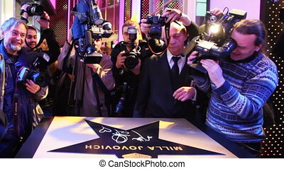 Journalists and photographers take photos star, it was signed famous actress Milla Jovovich