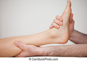 Foot being held by a doctor indoors