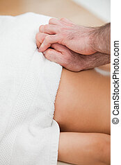 Close-up of doctor massaging the back of his patient in a...