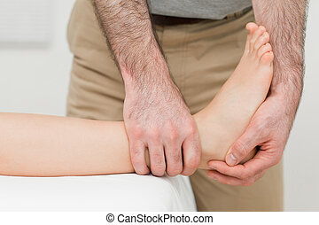Ankle of a patient being manipulated