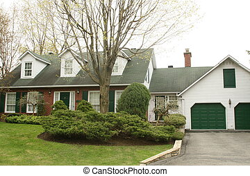 Cape Cod style house with garages - Brick cape cod style...