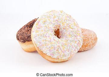 Three doughnuts with icing sugar