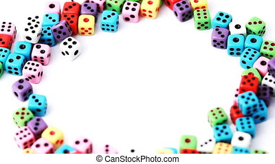 many colorful dice stacked in circle rotate on white...